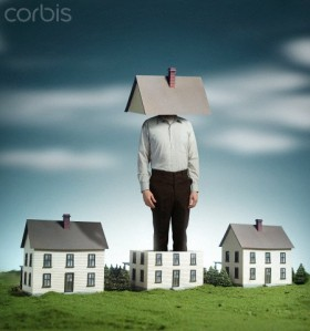 Tall man standing in too small house with roof on head